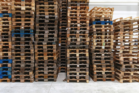 pallet: Used wooden Euro pallets in distribution warehouse Stock Photo