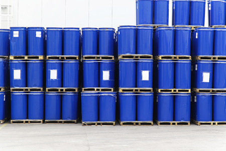 liquid material: Blue steel barrels with liquid material for factory Stock Photo