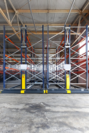 Mobile roller racking system in distribution warehouse photo
