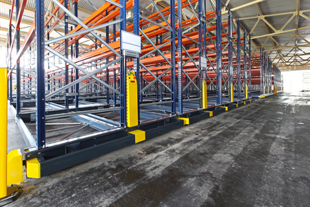 Mobile roller shelving system in distribution warehouse photo