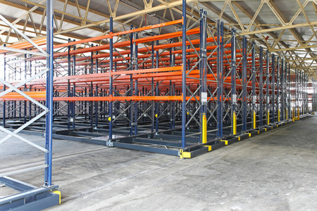 Mobile shelving roller system in distribution warehouse photo