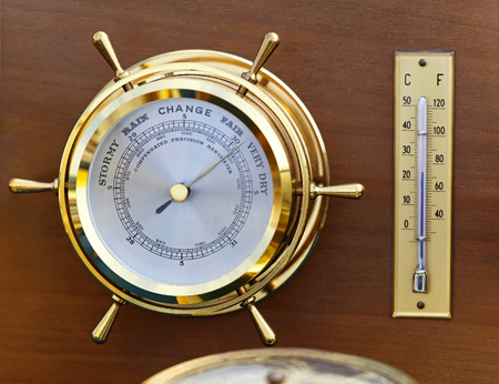 weather gauge: Retro style brass barometer and thermomether weather station