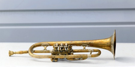 bended: Old battered and bended trumpet in bad condition Stock Photo