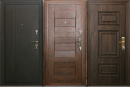 Conceptual choice of three closed doors photo