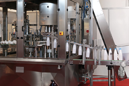 milk production: Dairy packaging and filling systems in milk factory Stock Photo