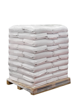 Food in sacks at transport pallet isolated photo