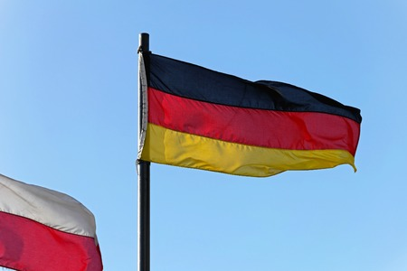 tricolour: The flag of Germany tricolour flying at wind