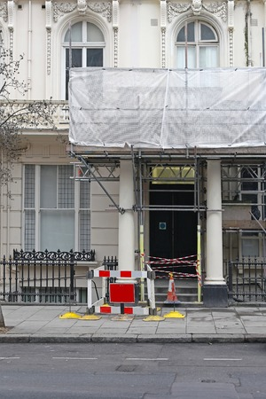 renovate old building facade: Old Victorian house improvement renovation in London Stock Photo