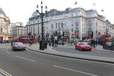 piccadilly: LONDON, UNITED KINGDOM - JANUARY 27  Piccadilly Circus on JANUARY 27, 2013  Piccadilly Circus intersection at West End in London, United Kingdom