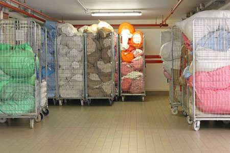 textile industry: Dirty sheets at laundry carts
