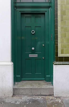 green door: Green door entrance at residential house with tiles