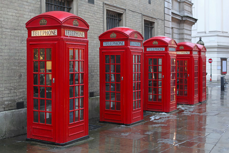 Five telephone booths at West End in London photo