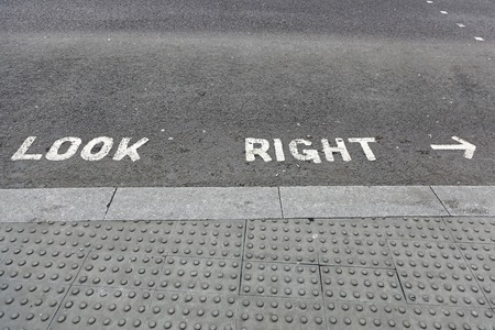 look at right: Look right safety sign at street crossing in London