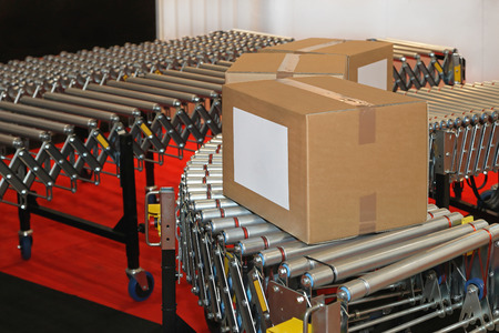 powered: Powered conveyor rollers for box transfer in factory Stock Photo