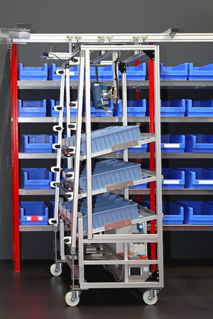 mail order: Sorting bins and cart in mail order distribution warehouse