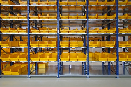 Storage bins and trays in distribution warehouse photo