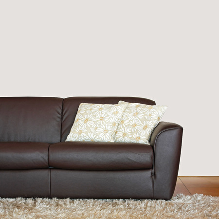 brown leather sofa: Brown leather sofa with pillows