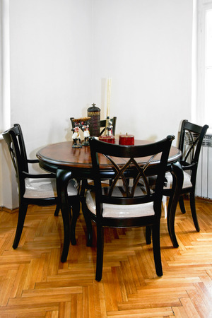 dining table and chairs: Black dining table with four chairs