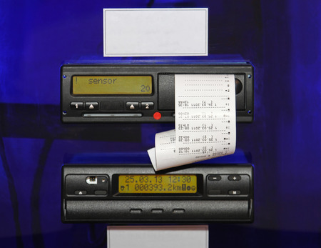 automatically: Digital tachograph device fitted to a truck and automatically record speed and distance