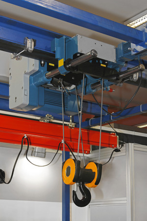 overhead crane: Overhead crane and hoist device mounted on a trolley  at beam Stock Photo