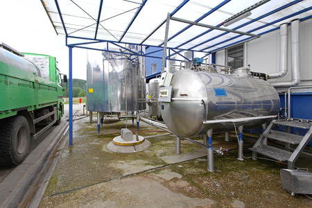 Dairy factory tanks for milk chilling and refrigeration photo