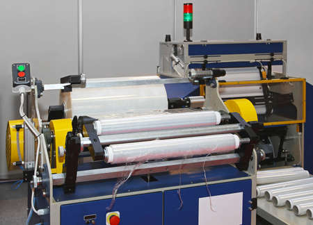 Packing machine from plastic foil roll photo