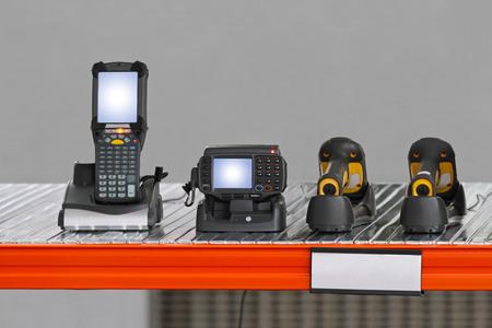 handheld: Handheld barcode scanner in distriburtion center warehouse