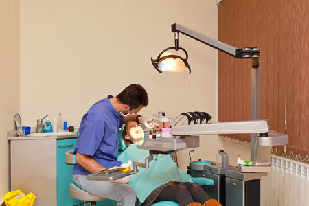 dental clinic: Dentist doctor and patient girl in dental clinic