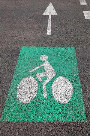 segregated: Arrow and bike lane sign at asphalt reserved for bicycles Stock Photo