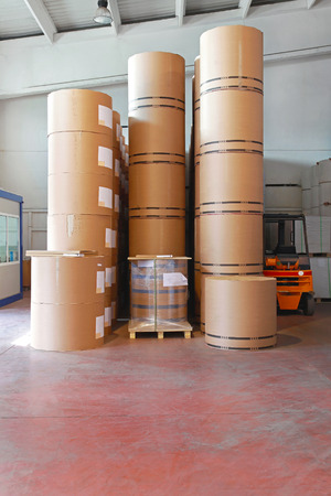 pile of paper: Big pile of printing paper rolls in warehouse