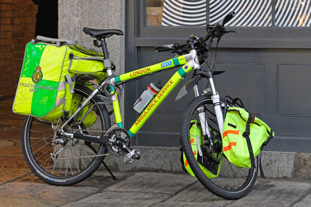 nhs: LONDON, UNITED KINGDOM - JANUARY 14  Cycle response unit in London on JANUARY 14, 2010  NHS Ambulance bicycle for emergency service with equipment in London, United Kingdom