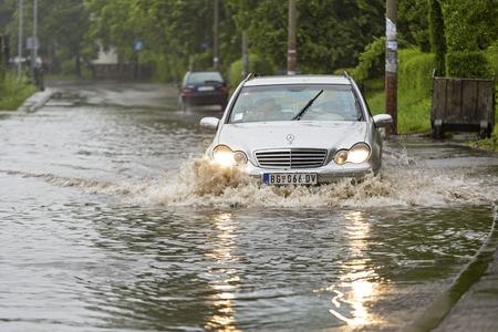 belgrade: BELGRADE, SERBIA - MAY 15  Flood in Belgrade on MAY 15, 2013  Driving through flooded street after river Sava overflow in Belgrade, Serbia  Editorial