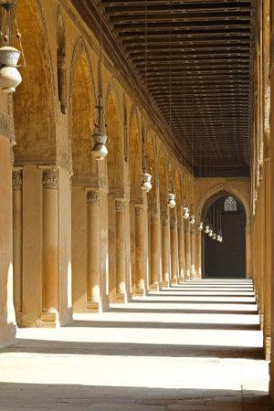 corridors: Corridors of Ibn Tulun Mosque courtyard in Cairo Editorial