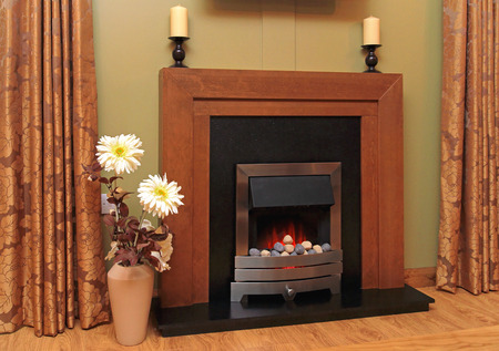 artificial flower: Artificial fire in fireplace with lava rocks