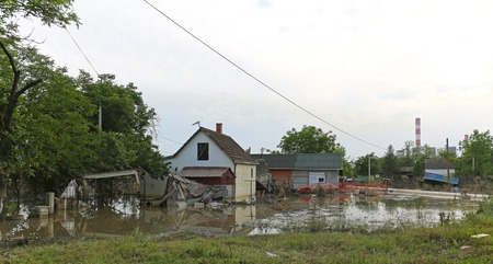 submerge: OBRENOVAC, SERBIA - MAY 24  Flood in Obrenovac on MAY 24, 2013  Flooded and ruined houses near power plant in Obrenovac, Serbia