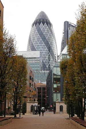 30 st mary axe: LONDON, UNITED KINGDOM - NOVEMBER 24  30 St Mary Axe in London on NOVEMBER 24, 2013  Famous Landmark Gherkin building skyscraper in London, United Kingdom