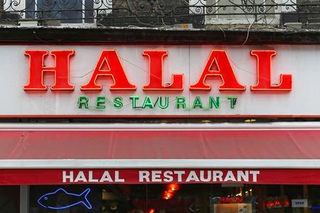 uk cuisine: LONDON, UNITED KINGDOM - NOVEMBER 24  Halal food restaurant in London on NOVEMBER 24, 2013  Big neon sign Halal at Middle East cuisine restaurant in London, United Kingdom  Editorial
