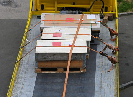 secured: Cargo crates tied at flatbed truck Stock Photo