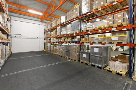 wholesale: Shelves loaded with merchandise in wholesale warehouse