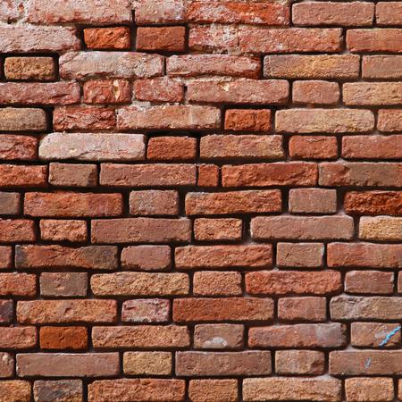 derelict: Orange brick wall background derelict Stock Photo