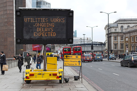 delays: LONDON, UNITED KINGDOM - JANUARY 25  Delays Expected traffic info board in London on JANUARY 25, 2013  Portable Variable Message Sign at Southwark in London, United Kingdom  Editorial