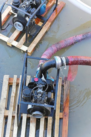 pumping: Water pumps at pallets pumping out floods Stock Photo