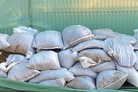 sandbag: Wall of sandbags and tarp for flood protection Stock Photo