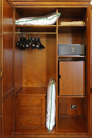 closets: Hotel closet with safety box and small fridge Stock Photo