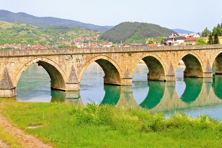 Mehmed Pasha Sokolovic old Ottoman bridge at river Drina photo