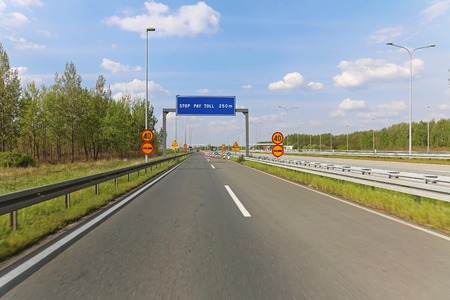 carriageway: Pay toll at dual carriageway highway road