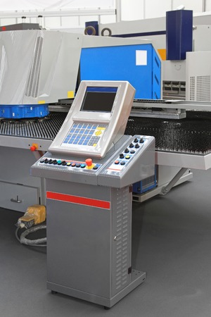 punch press: Automated turret punch press machine in factory
