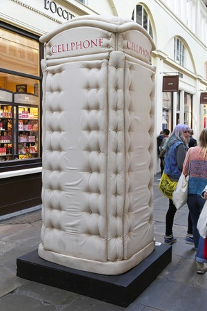 cell phone booth: LONDON, UNITED KINGDOM - JUNE 23: Telephone booth in London on JUNE 23, 2012. Padded Cell Phone Box from Bert Gilbert at Covent Garden in London,  United Kingdom.