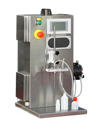 filling out: Machine for filling of liquid products isolated included clipping path