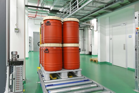 chemical industry: Plastic barrels at automated storage and retrieval system in warehouse